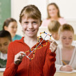 Student holding helix in classroom — Stock Photo #18784841