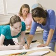 Stock Photo: Students working on project in classroom