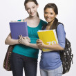 Stock Photo: Students carrying book bag, backpack and notebooks