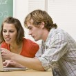 Students studying together in classroom — Stock Photo