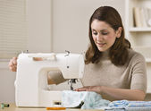 Woman Using Sewing Machine — Stock Photo