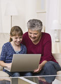 Grandmother and Granddaughter Using Laptop — Stock Photo
