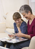 Grandmother and Granddaughter Looking at Photos — Stock Photo