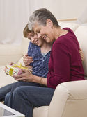 Grandma and Granddaughter with Present — Stock Photo