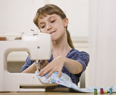 Girl on Sewing Machine — Stock Photo
