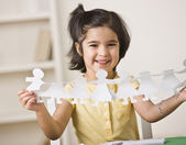 Girl Making Paper Dolls — Stock Photo