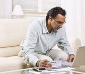 Man Paying Bills With Laptop — Stock Photo