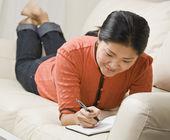 Woman Writing in Book — Stock Photo