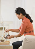 Woman Pouring Tea — Stock Photo