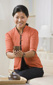 Asian woman serving tea. — Stock Photo