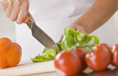Woman Slicing Produce — Stock Photo