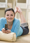 Attractive woman with cell phone. — Stock Photo