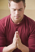 Attractive male in prayer — Stock Photo