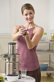 Woman Holding Glass of Juice — Stock Photo
