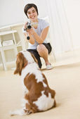 Woman Taking Picture of Dog — Stock Photo