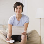 Smirking woman with paper. — Stock Photo