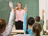 Students answering teacher question — Stock Photo