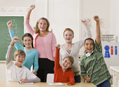Teacher and students cheering — Stock Photo