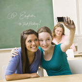 Students taking self-portrait in classroom — Stock Photo