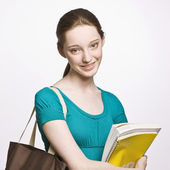 Student carrying book bag and notebook — Stock Photo