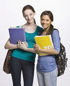 Students carrying book bag, backpack and notebooks — Stock Photo
