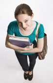 Student carrying books and book bag — Stock Photo