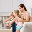 Mother showing children laptop — Stock Photo