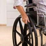 Senior woman sitting in wheelchair — Stock Photo
