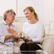 Daughter giving mother gift — Stock Photo
