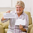 Senior woman holding innernotification — Stock Photo #18792591