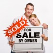 Couple holding for sale sign — Stock Photo #18794275