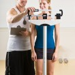 Personal training weight woman in health club — Stock Photo