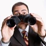 Businessman looking through binoculars — Stock Photo #18796835