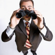 Businessman looking through binoculars — Stock Photo #18796891