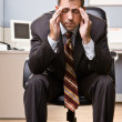 Stock Photo: Businessman with headache