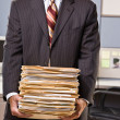 Businessman carrying stack of file folders — Foto Stock