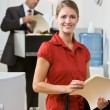 Businesswoman holding file folder - Stock Photo