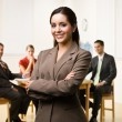 Businesswoman smiling - Stock Photo