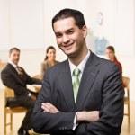 Businessman smiling — Stock Photo