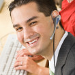 Businessman talking on headsets — Stock Photo