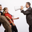 Businessman shouting at co-workers with megaphone — Stock Photo #18797983