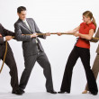 Stock Photo: Business playing tug-of-war