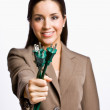 Businesswoman  holding electrical plugs — Stock Photo