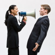 Businesswoman using megaphone — Stock Photo
