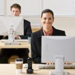 Business typing on computers — Stock Photo #18799337