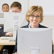 Businesswoman working at desk — Stock Photo