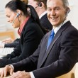 Business talking on headsets — Stock Photo