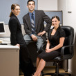Stock Photo: Co-workers sitting in office cubicle
