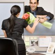 Businessman giving co-worker flowers — Stock Photo