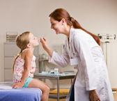 Doctor checking girl temperature — Stock Photo